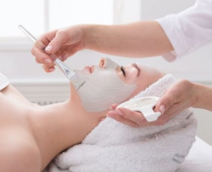 women with clay mask facial
