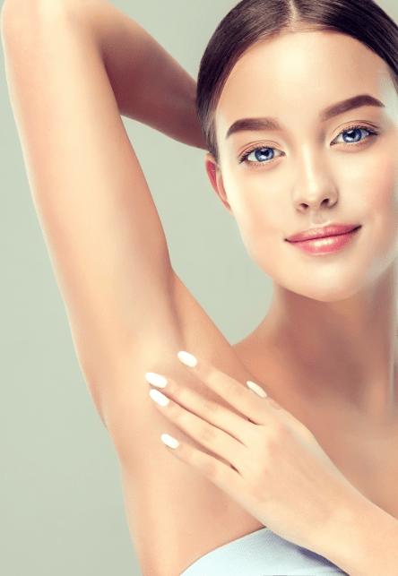 woman touching her armpit