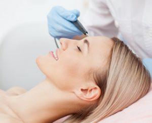 women getting skin treatment